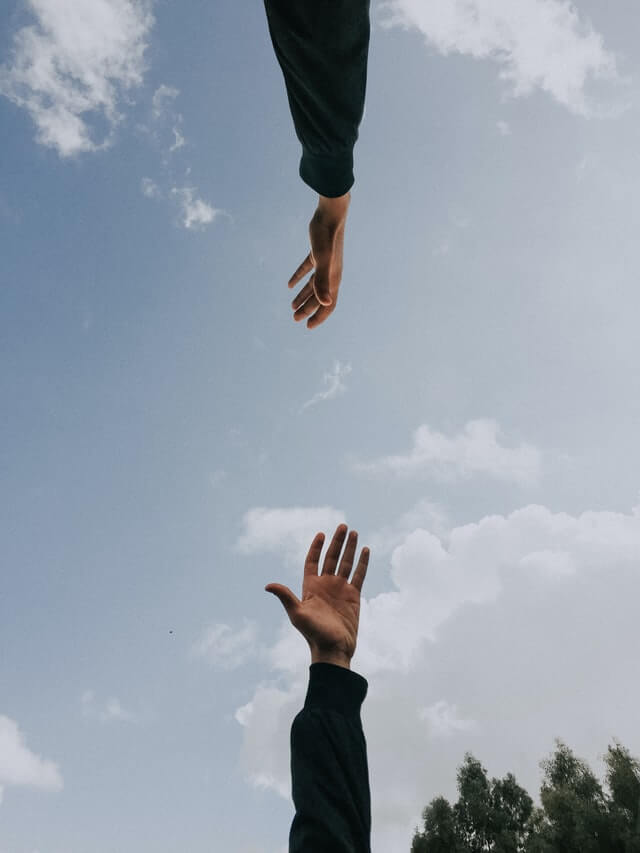 photo of two hands reaching out
