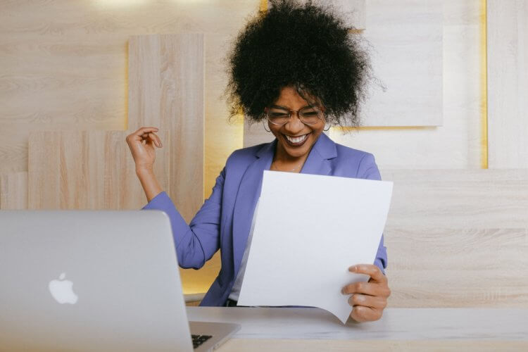 happy lawyer looking at a document