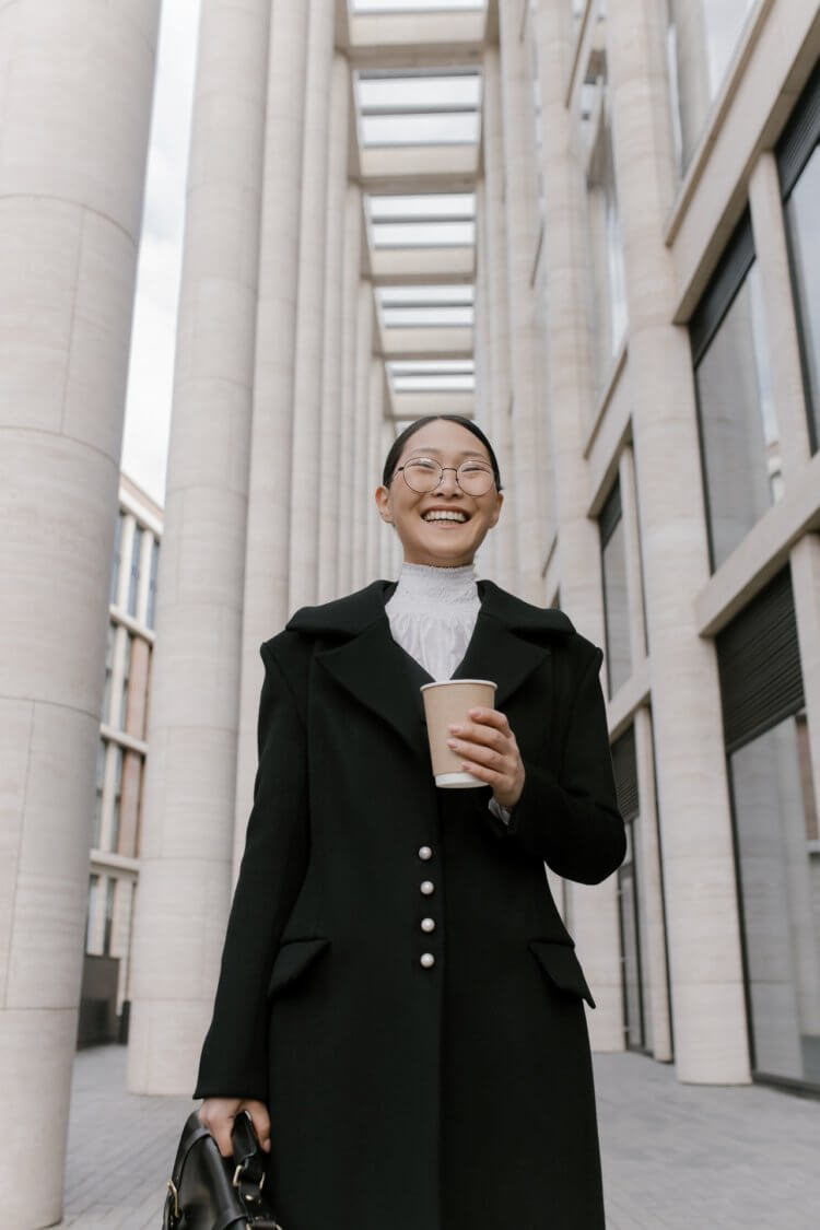 happy lawyer holding a cup of coffee