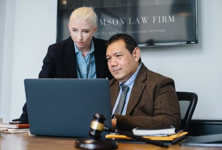 Two legal professionals learning about how paralegal automation can benefit them