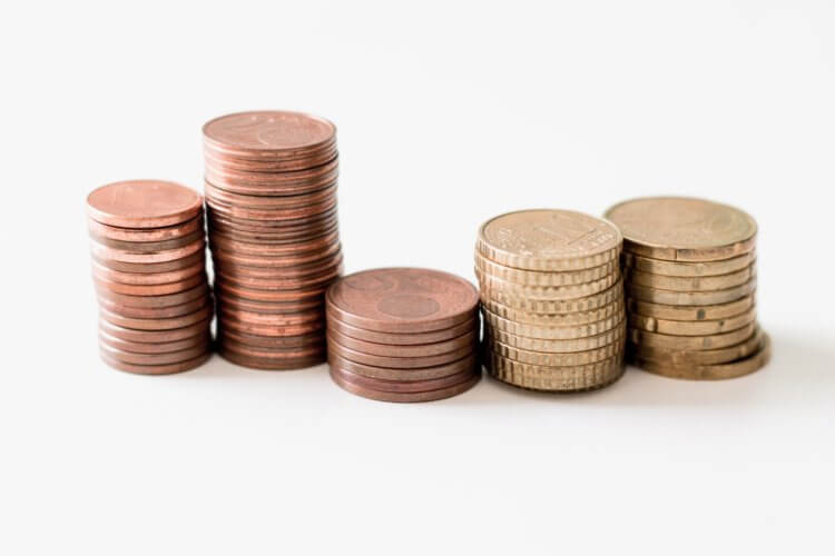 Photo of coins stacked symbolizing Law Firm profit sharing formulas