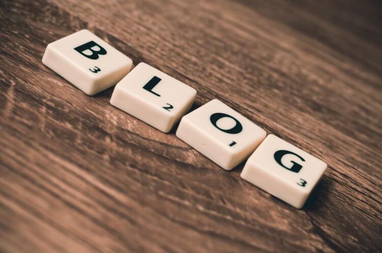 scrabble tiles spelling the word blog